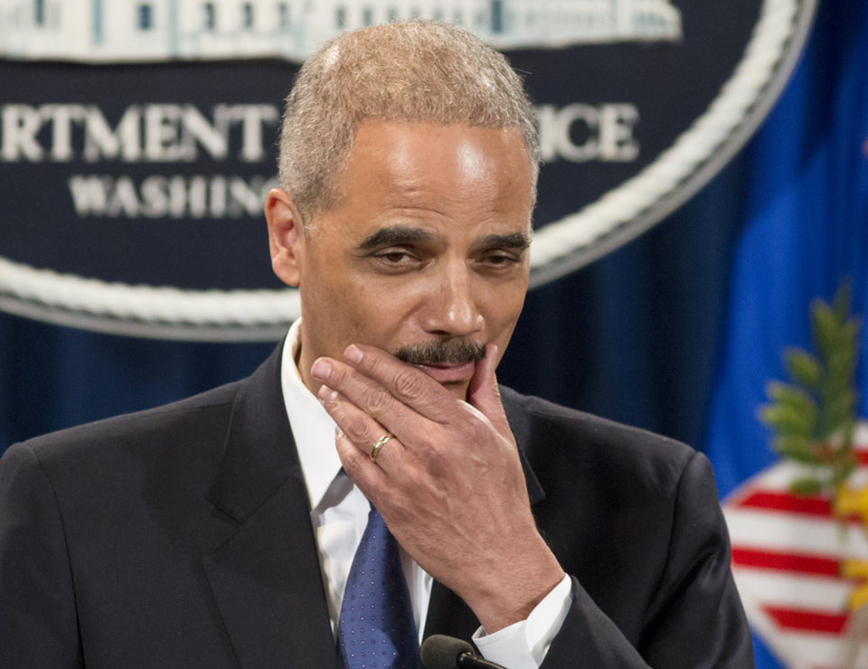 Photo - Attorney General Eric Holder pauses during a news conference at the Justice Department in Washington, Tuesday, May 14, 2013. Holder said he's ordered a Justice Department investigation into the Internal Revenue Service's targeting of conservative groups for extra tax scrutiny.   (AP Photo/J. Scott Applewhite)