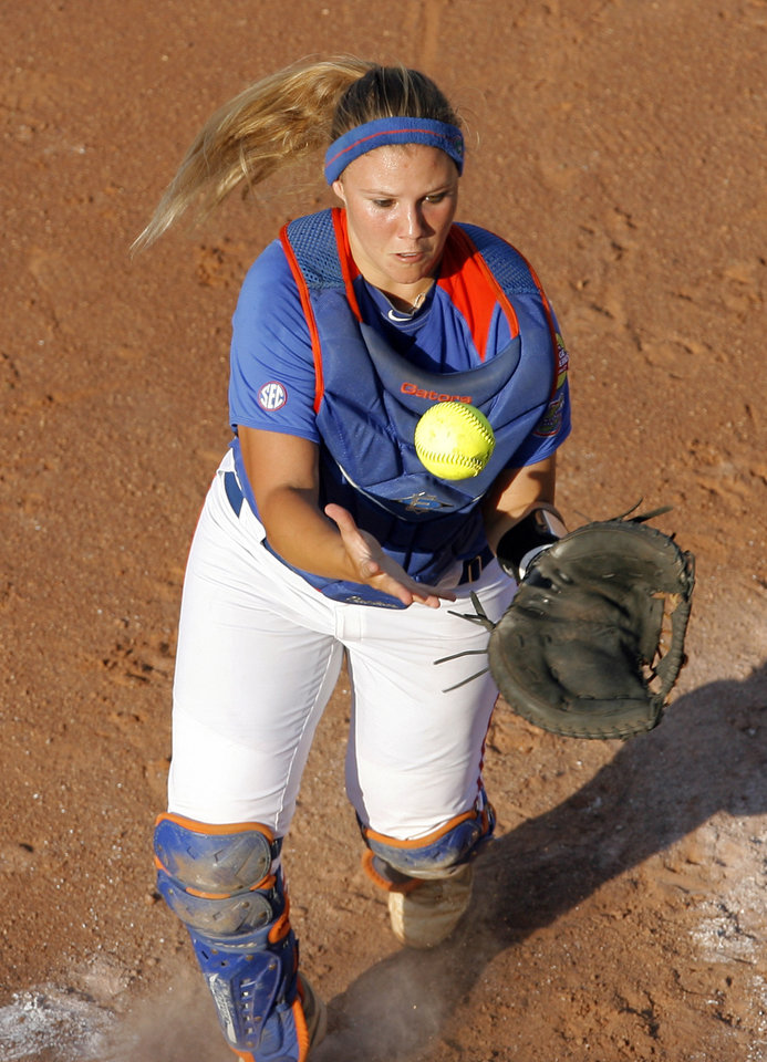 Photo - Florida's Tiffany DeFelice (28) catches a foul ball during the Women's College World Series game between Florida and Alabama at the ASA Hall of Fame Stadium in Oklahoma City, Sunday, June 5, 2011. Photo by Garett Fisbeck, The Oklahoman