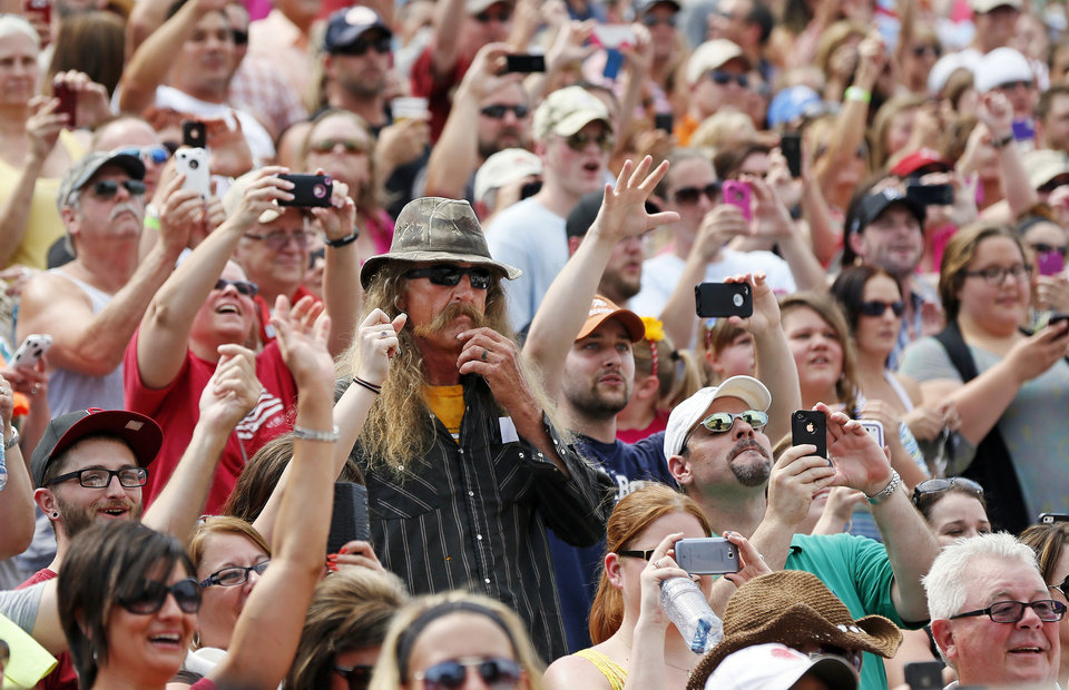 Photo - Fans cheer for Garth Brooks during the Oklahoma Twister Relief Concert, benefiting victims of the May tornadoes, at Gaylord Family - Oklahoma Memorial Stadium on the campus of the University of Oklahoma in Norman, Okla., Saturday, July 6, 2013. Photo by Nate Billings, The Oklahoman