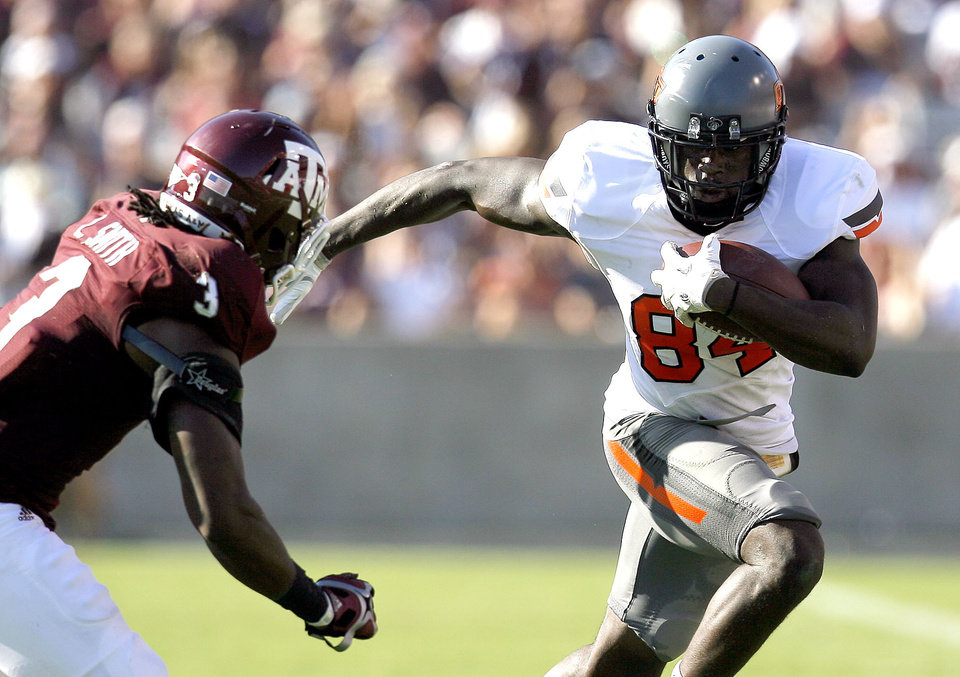 Oklahoma State's Hubert Anyiam tries to get by Texas A&M 's Lionel Smith in the second half of the Cowboys' 30-29 win on Saturday in College Station, Texas. Photo by Sarah Phipps, The Oklahoman