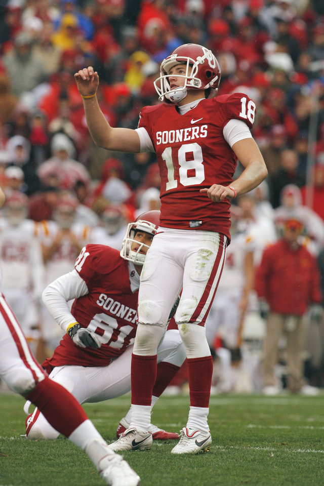 Photo - Oklahoma's Michael Hunnicutt (18) watches a kick during a college football game between the University of Oklahoma Sooners (OU) and the Iowa State University Cyclones (ISU) at Gaylord Family-Oklahoma Memorial Stadium in Norman, Okla., Saturday, Nov. 26, 2011. Photo by Steve Sinsey, The Oklahoman