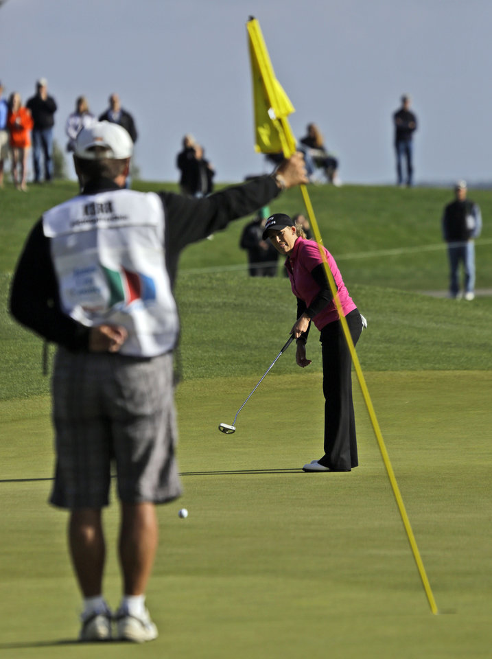Cristie Kerr watches her putt on the  18th hole during the third round of the Kingsmill Championship LPGA golf tournament in Williamsburg, Va., Saturday, May 4, 2013. (AP Photo/Steve Helber)