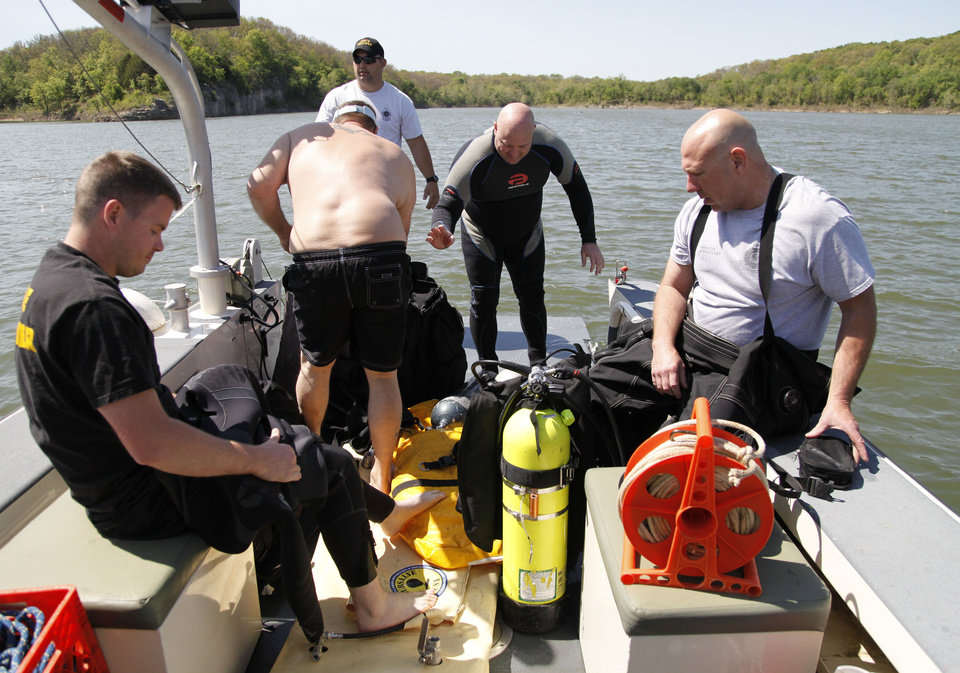 Photo - OHP troopers prepare their dive equipment as the Oklahoma Highway Patrol Dive Team spends the day floating a submerged boat and car from the bottom of Lake Tenkiller near Gore, OK, as part of ongoing training exercises, Tuesday, May 6, 2014,  Photo by Paul Hellstern, The Oklahoman