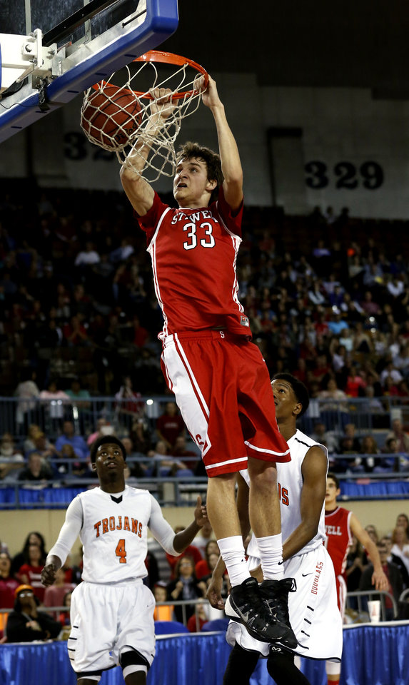 """Photo - Stilwell's Matt Lea  6' 8"""" dunks as the Stilwell Indians play the Douglass Trojans in the finals of the State Class 4A Boys Basketball Tournament at the Fairgrounds Arena on Saturday, March 15, 2014, in Oklahoma City, Okla. Photo by Steve Sisney, The Oklahoman"""
