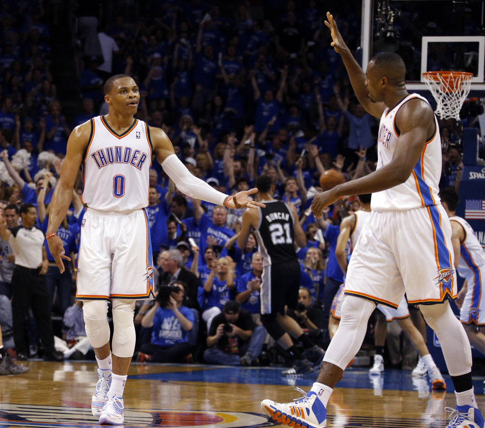 Photo - Oklahoma City's Serge Ibaka (9) and Russell Westbrook (0) celebrate during Game 3 of the Western Conference Finals in the NBA playoffs between the Oklahoma City Thunder and the San Antonio Spurs at Chesapeake Energy Arena in Oklahoma City, Sunday, May 25, 2014. Photo by Bryan Terry, The Oklahoman