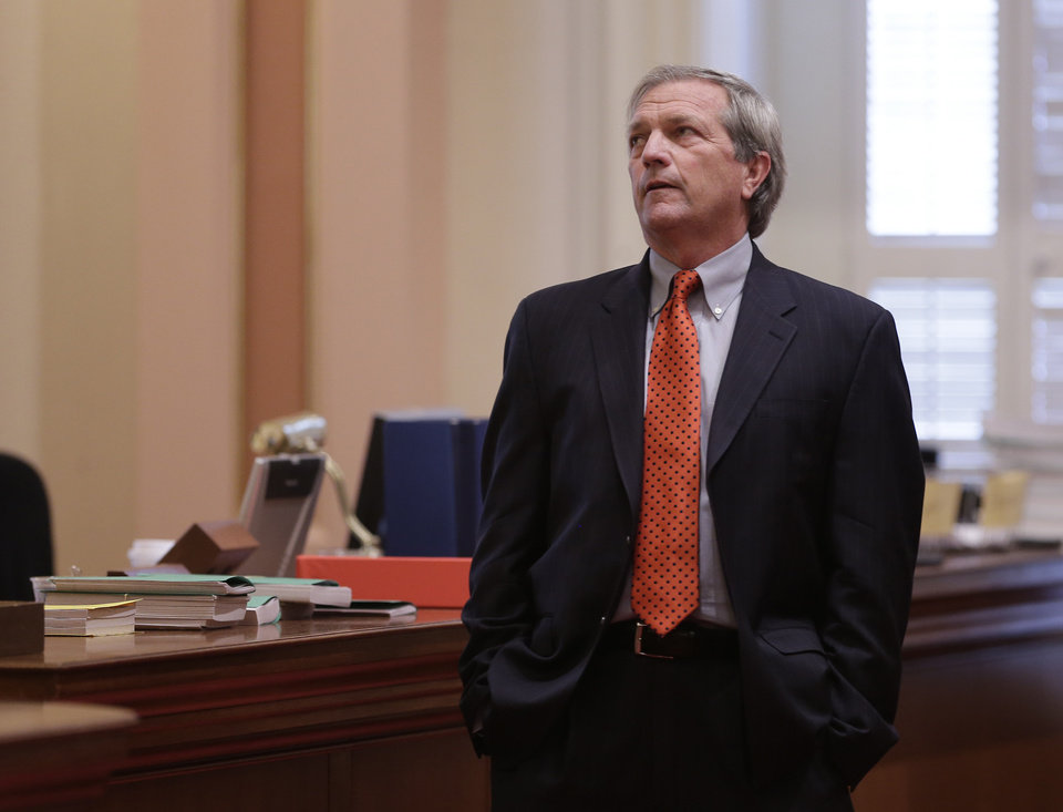 Photo - State Sen. Mark DeSaulnier, D-Concord, watches as the votes are posted for his measure that would tie California's  corporate tax rate  to executive compensation during the Senate session in Sacramento, Calif., Wednesday, May 28, 2014.  DeSaulnier's bill, SB1173 fell short of majority support on a 19-16 vote and was placed on call.(AP Photo/Rich Pedroncelli)