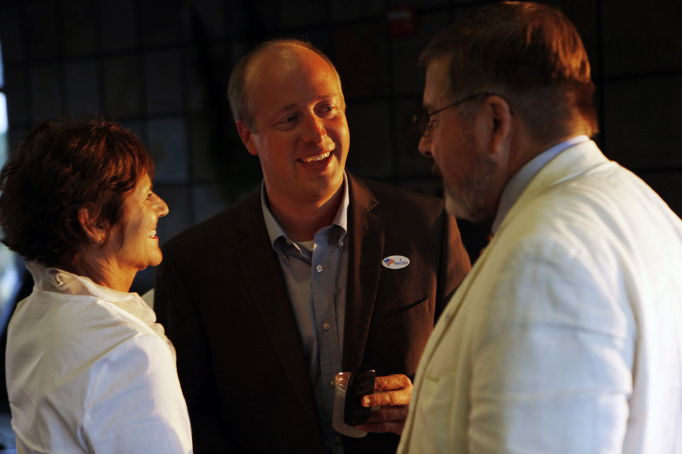 Photo - Brian Maughan greets Kathy and John Williams, of Oklahoma City, during a watch party for Brian Maughan, incumbent candidate for county commissioner, Tuesday, June 26, 2012.  Photo by Garett Fisbeck, The Oklahoman