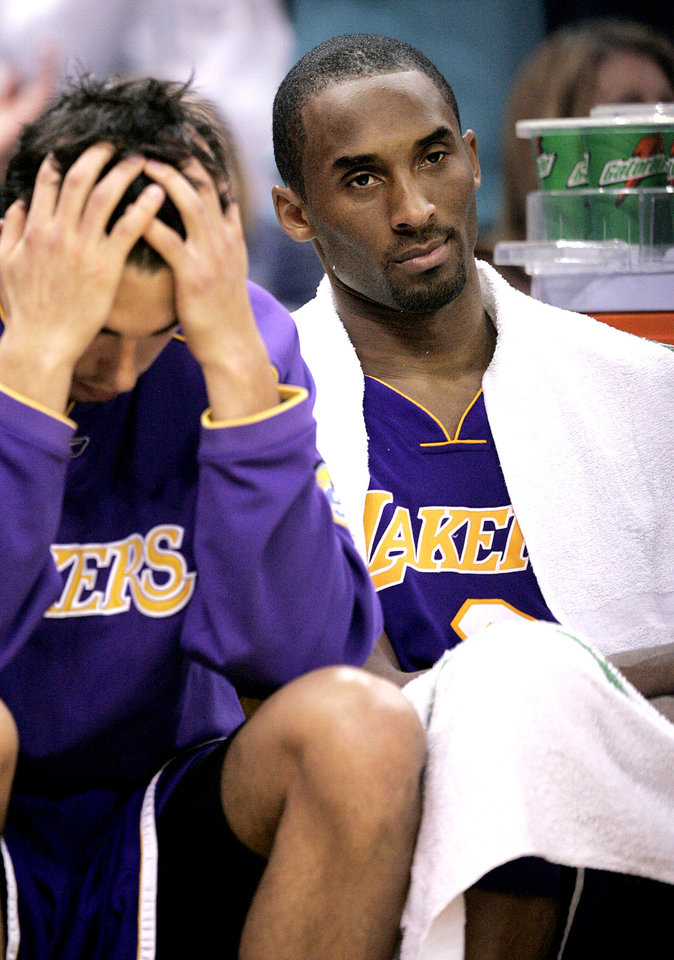 Photo - Kobe Bryant of the Los Angeles Lakers sits on the bench in the fourth quarter of their loss to the New Orleans/Oklahoma City Hornets 106-90 at the Ford Center in Oklahoma City, Feb. 4, 2006.  By Bryan Terry/The Okahoman
