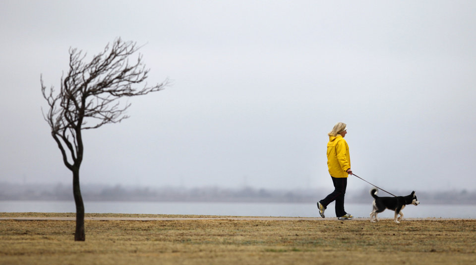 Kim Davis walks her dog, Mako, around Lake Hefner in Oklahoma City , March  8 , 2011. Photo by Steve Gooch, The Oklahoman