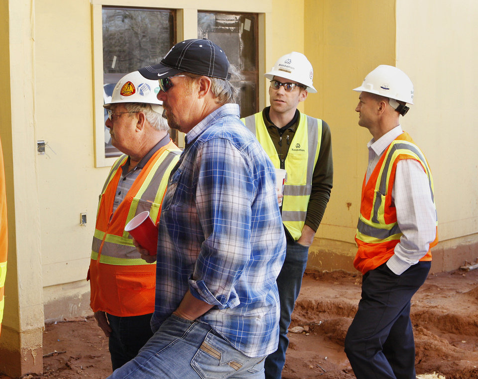 Photo - Toby Keith, foreground, stands with construction workers at the OK Kids Korral, a lodge being built for families of pediatric cancer patients.