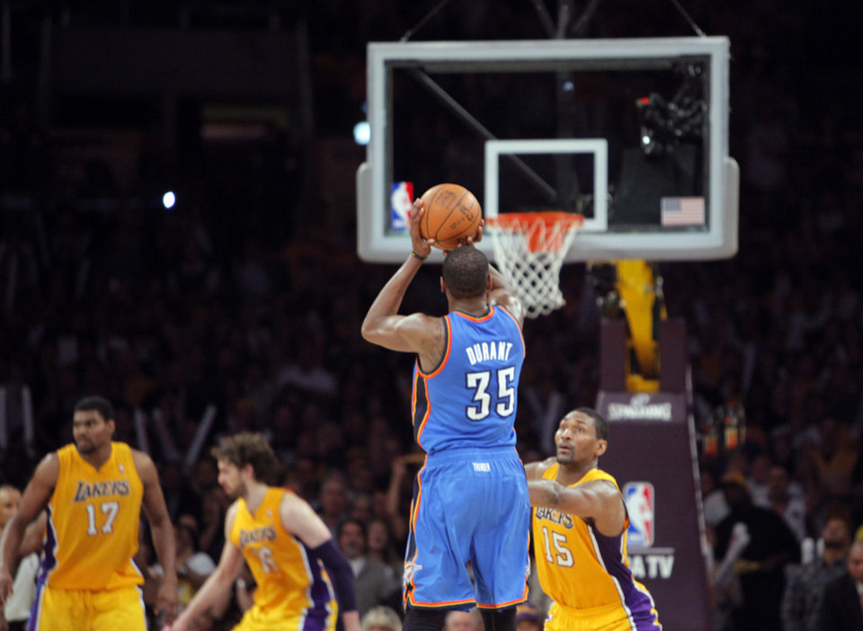 Oklahoma City�s Kevin Durant shoots the game winning three-point shot over Los Angeles� Metta World Peace during Game 4 on Saturday. Photo by Nate Billings, The Oklahoman