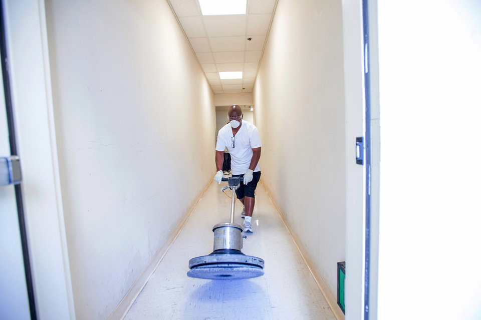 Photo - Arthur Scott, who was paroled in March 2014 after serving time on his 22nd auto theft conviction, buffs a floor as part of a Goodwill Industries custodial skills class on Tuesday, June 24, 2014, in Oakland, Calif. Scott, who says he is determined to stay out of jail, credits the Goodwill program for helping him start a new life. (AP Photo/Noah Berger)