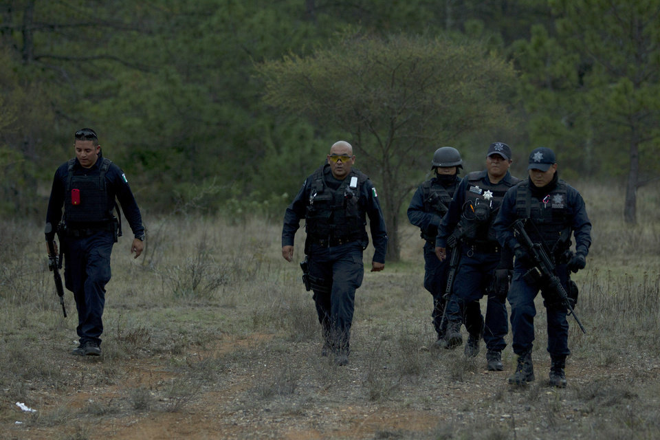 Federal police officers return from the site where a plane allegedly carrying U.S-born singer Jenni Rivera crashed near Iturbide, Mexico Sunday, Dec. 9, 2012. The wreckage of a small plane believed to be carrying Jenni Rivera, the U.S-born singer whose soulful voice and unfettered discussion of a series of personal travails made her a Mexican-American superstar, was found in northern Mexico on Sunday. Authorities said there were no survivors. (AP Photo/Hans Maximo Musielik)