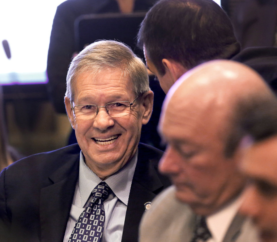 Photo - Sen. Frank Simpson smiles as he listens to comments from Health Commissioner Terry Cline  before both speak in support of a bill during a Senate committee hearing at the state Capitol on Monday, Feb. 18, 2013. By a 6-2 vote, an Oklahoma Senate committee killed Senate Bill 36  that would have permitted cities and towns to craft their own anti-smoking laws.   Photo by Jim Beckel, The Oklahoman