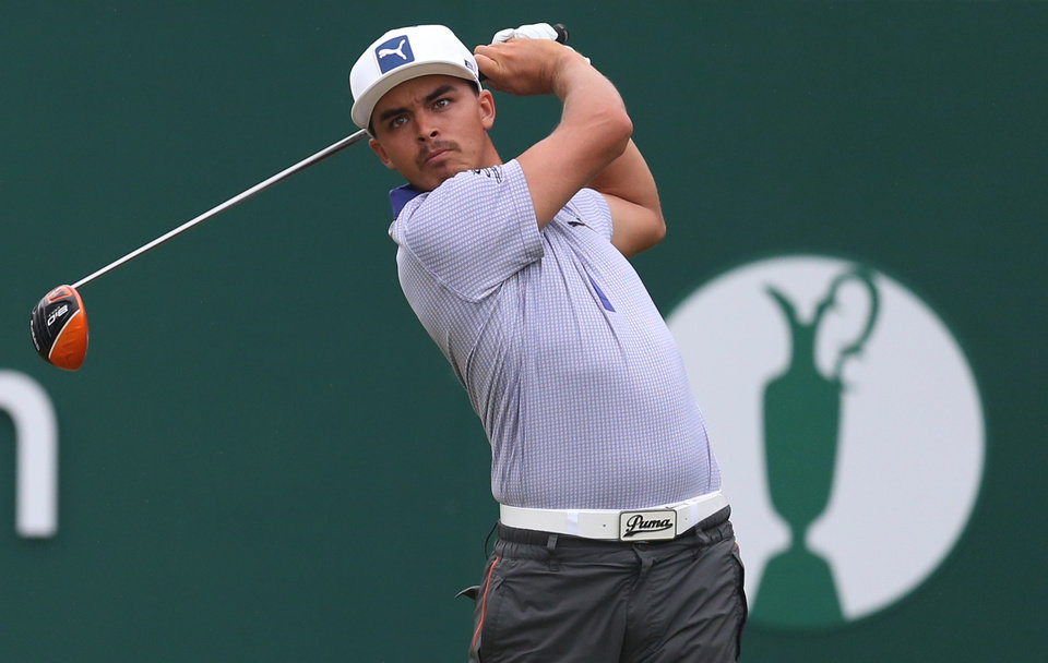 Photo - Rickie Fowler of the US plays a shot off the 1st tee during the third day of the British Open Golf championship at the Royal Liverpool golf club, Hoylake, England, Saturday July 19, 2014. (AP Photo/Scott Heppell)