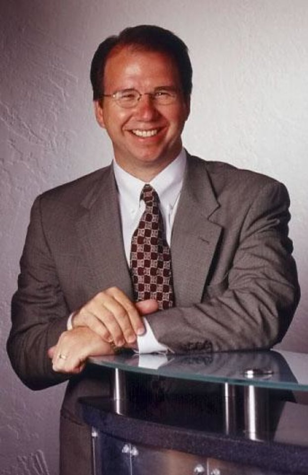 Photo -  MURDER, DEATH: Photo of Robert Dale (Rob) Andrew, senior vice president of Jordan Associates.  Andrew was found shot to death inside garage at house of his family, 6112 Shaftsbury Drive. His wife, Brenda Andrew, suffered a superficial wound - possibly a gunshot - to her left arm.