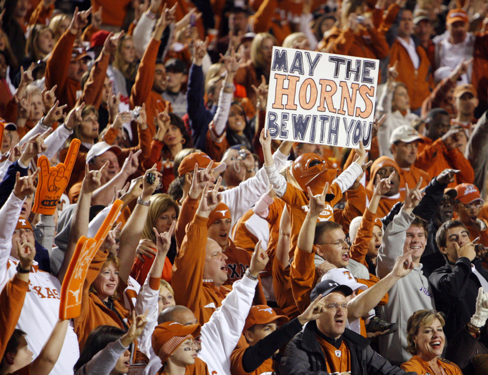 Photo - Texas fans celebrate after the college football game between the Oklahoma State University Cowboys (OSU) and the University of Texas Longhorns (UT) at Boone Pickens Stadium in Stillwater, Okla., Saturday, Oct. 31, 2009. Texas won, 41-14. Photo by Nate Billings, The Oklahoman