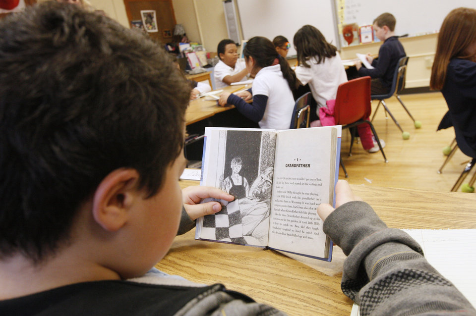 "Third-grader Tylas Rhodes, 9, reads from the book ""Stone Fox"" Students at Sequoyah Elementary in northwest Oklahoma City. <strong>PAUL B. SOUTHERLAND - THE OKLAHOMAN</strong>"