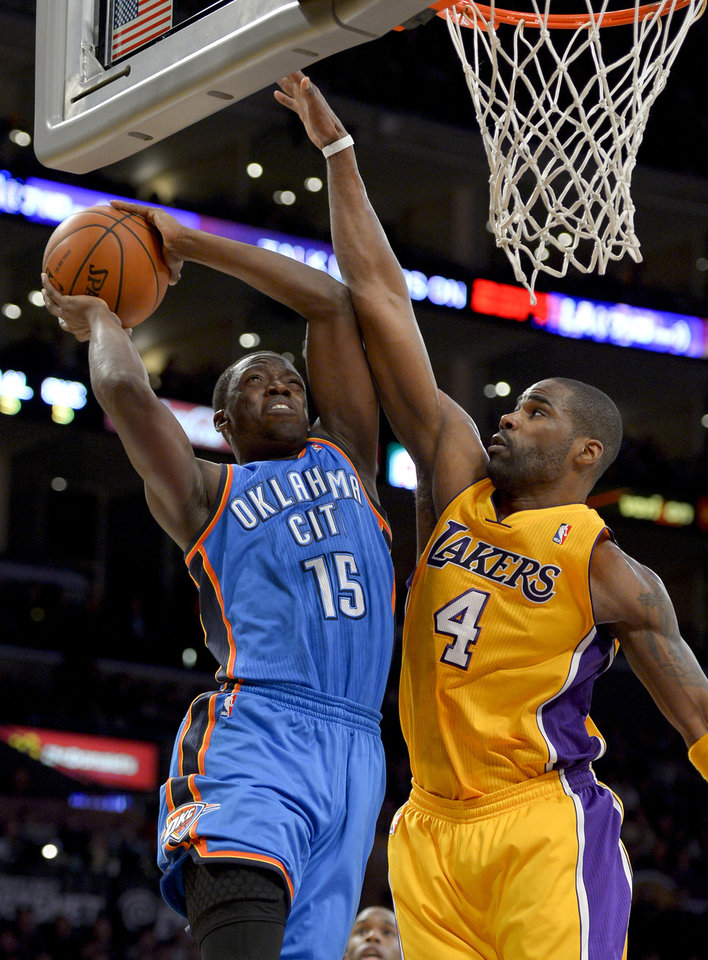 Oklahoma City Thunder guard Reggie Jackson, left, shoots over Los Angeles Lakers forward Antawn Jamison during the first half of their NBA basketball game, Friday, Jan. 11, 2013, in Los Angeles. (AP Photo/Mark J. Terrill)