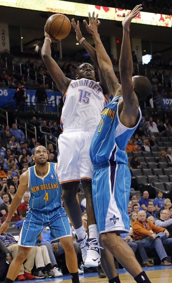 Oklahoma City Thunder's Reggie Jackson (15) shoots the ball over New Orleans Hornets' Lance Thomas (42) during the NBA basketball game between the Oklahoma City Thunder and the New Orleans Hornets at the Chesapeake Energy Arena on Wednesday, Feb. 27, 2013, in Oklahoma City, Okla. Photo by Chris Landsberger, The Oklahoman
