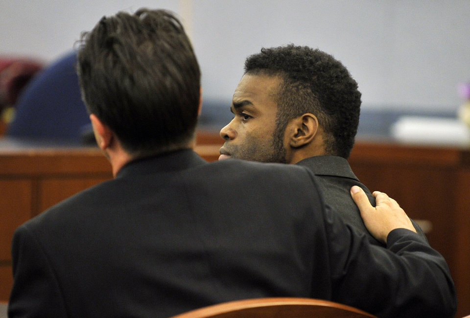 Photo - Jason Omar Griffith, right, is comforted by his attorney Jeff Banks after a guilty verdict was read during his murder trial at the Regional Justice Center on Thursday, May 22, 2014, in Las Vegas. Griffith was convict of second degree murder of his girlfriend and Luxor