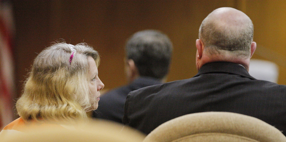 Rebecca Bryan talking with her attorney Gary James in the courtroom during her preliminary hearing at the Canadian County Courthouse in El Reno Wednesday, April 4, 2012.  Bryan appeared in court on a first-degree murder charge. She is accused of killing her husband, Keith Bryan, 52, who was the Nichols Hills fire chief at the time. Photo by Paul B. Southerland, The Oklahoman