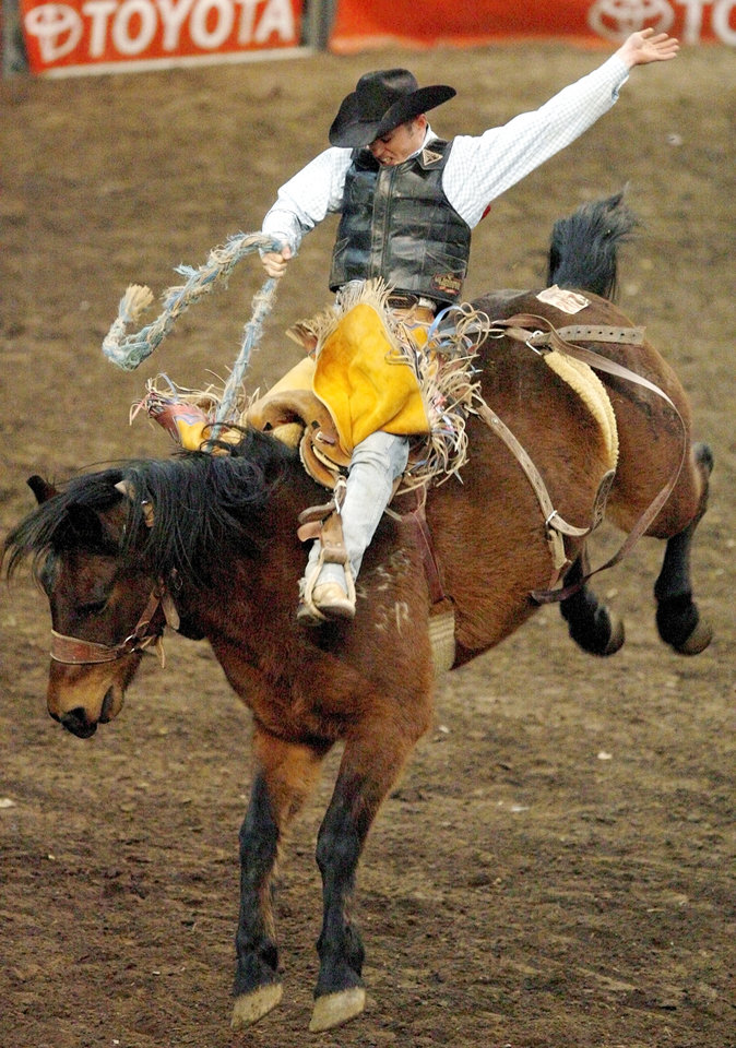 Jet McCoy of Ada, Okla., rides to an 83 in the saddle bronc competition during the International Finals Rodeo (IFR 38) at State Fair Arena in Oklahoma City, Saturday afternoon, January 19, 2008. BY NATE BILLINGS, THE OKLAHOMAN ORG XMIT: KOD