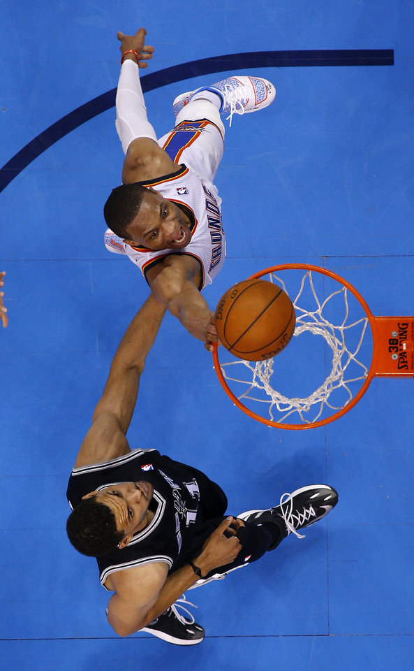 Photo - Oklahoma City's Russell Westbrook (0) goes to the basket beside San Antonio's Jeff Ayres (11) during Game 3 of the Western Conference Finals in the NBA playoffs between the Oklahoma City Thunder and the San Antonio Spurs at Chesapeake Energy Arena in Oklahoma City, Sunday, May 25, 2014. Photo by Bryan Terry, The Oklahoman