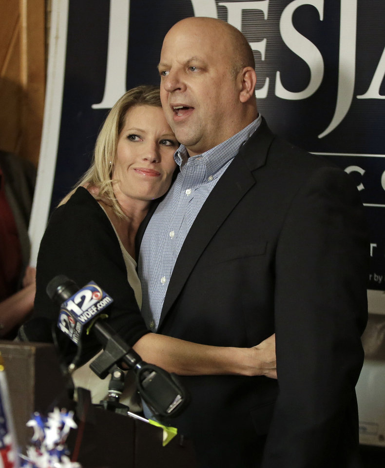 "FILE -- In this Nov. 6, 2012 file photo, U.S. Rep. Scott DesJarlais, R-Tenn., gets a hug from his current wife, Amy, as he speaks to supporters on election night in Winchester, Tenn. DesJarlais defeated Democrat Eric Stewart in the state's 4th Congressional District race. DesJarlais testified during divorce proceedings that he and his former wife, Susan, made a ""mutual"" decision for her to have two abortions, according to divorce transcripts released Thursday, Nov. 15, 2012. (AP Photo/Mark Humphrey/file)"