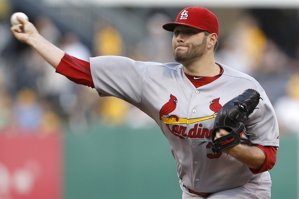 Photo - St. Louis Cardinals starting pitcher Lance Lynn throws against the Pittsburgh Pirates in the first inning of the baseball game on Tuesday, Aug. 26, 2014, in Pittsburgh. (AP Photo/Keith Srakocic)