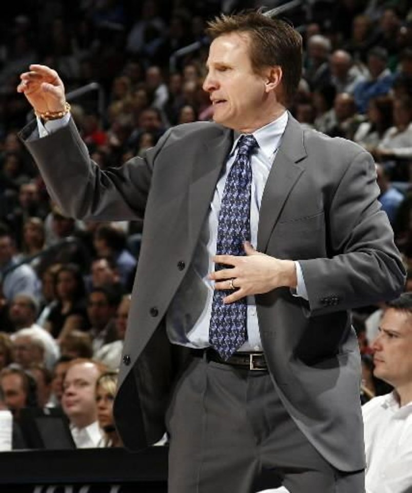 Oklahoma City head coach  Scott  Brooks gives instructions to his team in the first half during the NBA basketball game between the Dallas Mavericks and the Oklahoma City Thunder at the Ford Center in Oklahoma City, March 2, 2009. BY NATE BILLINGS