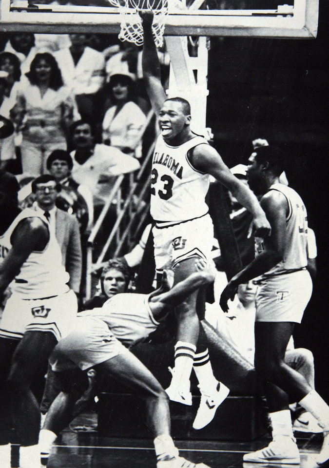 Former OU basketball player Wayman Tisdale. DALLAS,  March 21 -AT THE FINAL BUZZER--Oklahoma center Wayman Tisdale (23) leaps in jubilation after the final buzzer in Dallas Thursday night after leading the Sooners to a 86084 overtime victory over Louisiana Tech. Louisiana Tech. guard Willie Bland, slaps the floor in disgust, foreground. Photo by Doug Hoke. Photo taken 3/21/1985, photo published 3/22/1985 in the Daily Oklahoman. ORG XMIT: KOD
