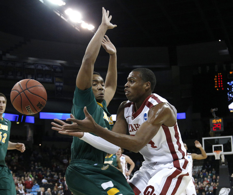 Photo - Oklahoma's Buddy Hield (24) looses control of the ball as North Dakota State's TrayVonn Wright (32) defends during the NCAA men's basketball tournament game between the University of Oklahoma and North Dakota State at the Spokane Arena in Spokane, Wash., Thursday, March 20, 2014. Photo by Sarah Phipps, The Oklahoman