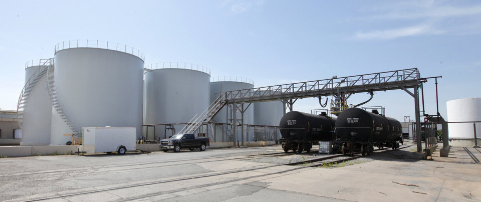 Photo -  Storage tanks with a capacity of 22 million pounds of seed oil will remain at the Producers Cooperative Oil Mill property at SW 25 and Council Road.    PAUL B. SOUTHERLAND -  PAUL B. SOUTHERLAND