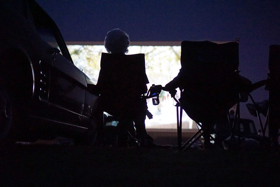 Photo - Geneva Alston and Charles Hall watch the movie at the Airline Drive-in movie theater in Ponca City Thursday, August 14, 2014. Photo by Doug Hoke, The Oklahoman