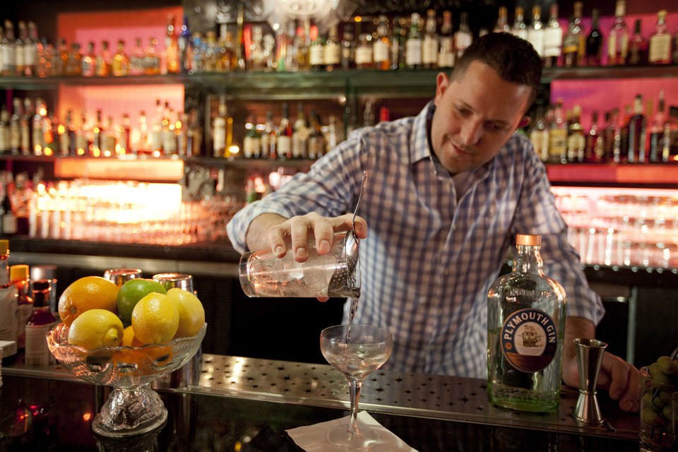 In this photo taken Thursday, Dec. 20, 2012, mixologist Jacques Bezuidenhout prepares a gin Martini cocktail in the Starlight Room of the Sir Francis Drake Hotel in San Francisco. The first rule of drinking on a diet is, don't. Surely you saw the recent study that found that Americans were getting almost as many empty calories from alcohol as from soft drinks. The second rule of drinking on a diet is that since you probably will ignore Rule No. 1, find a way to enjoy alcohol without letting it swamp your healthy intentions. (AP Photo/Eric Risberg)