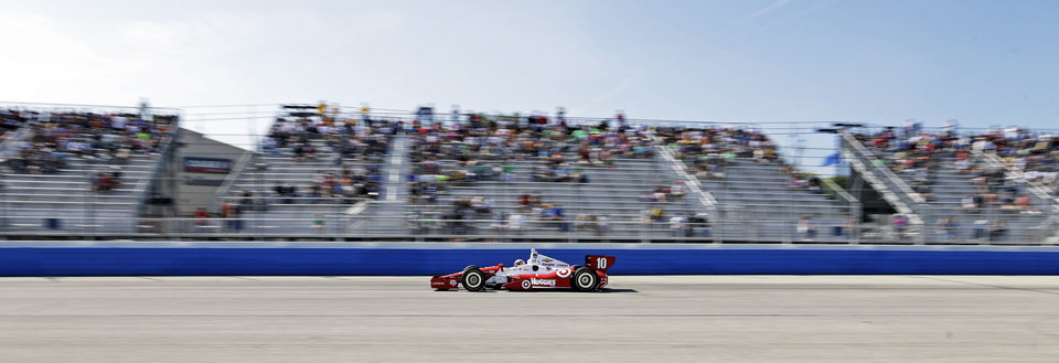 Photo - Tony Kanaan makes his way through turn four during the Milwaukee Mile IndyCar auto race Sunday, Aug. 17, 2014, in West Allis, Wis. (AP Photo/Morry Gash)