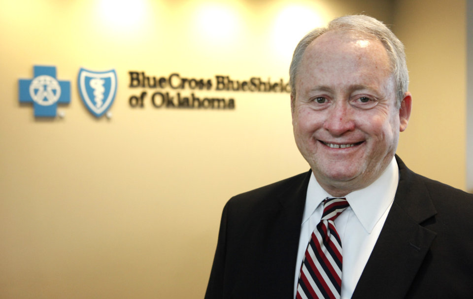 Photo - Ted Haynes, chief executive of BlueCross and BlueShield of Oklahoma, visits the company's Oklahoma City offices on the third floor of the IBC Bank building on Northwest Expressway.  Photo by David McDaniel, The Oklahoman  David McDaniel