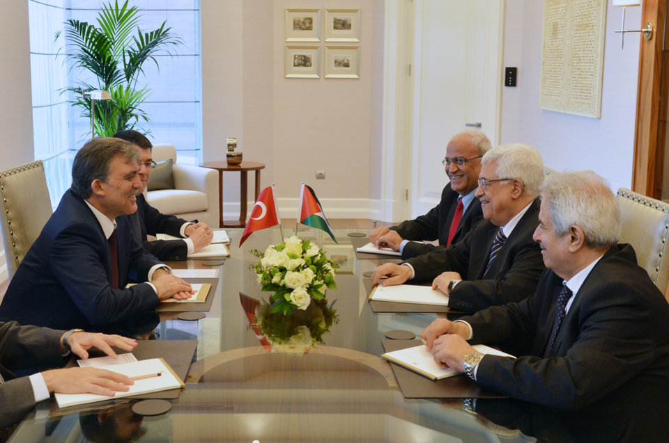 Photo - In this photo provided by Turkish Presidency Press Service,Turkey's President Abdullah Gul, left, and Palestinian leader Mahmoud Abbas, second right, seen during a meeting in Ankara, Turkey, Monday, April 22, 2013. U.S. Secretary of State John Kerry met with Abbas Sunday in Istanbul, in an effort to relaunch Mideast peace efforts, one of President Barack Obama's foreign policy priorities.(AP Photo/irfan Yildiz)