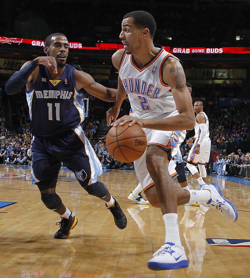 Oklahoma City's Thabo Sefolosha (2)  drives against Memphis' Mike Conley Jr. (11) during the NBA basketball game between the Oklahoma City Thunder and the Memphis Grizzlies at Chesapeake Energy Arena on Wednesday, Nov. 14, 2012, in Oklahoma City, Okla.   Photo by Chris Landsberger, The Oklahoman