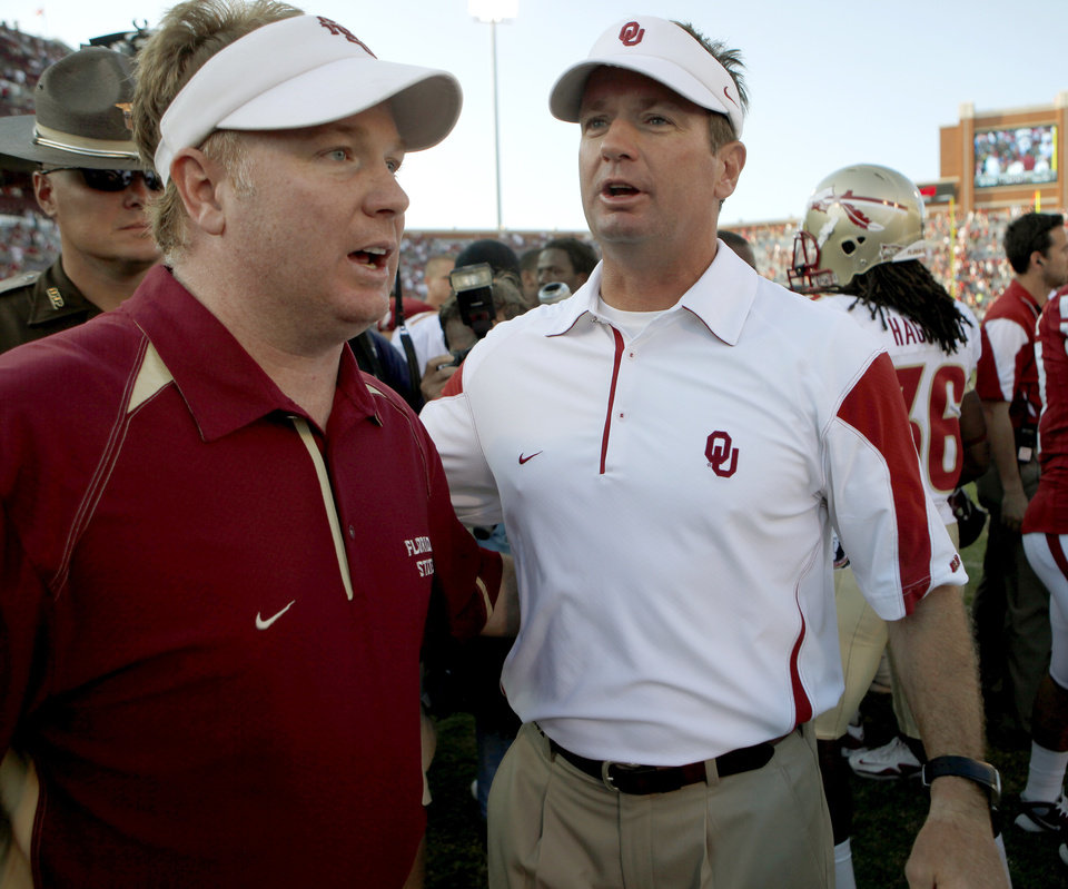 Photo - Florida State's Mark Stoops and OU coach Bob Stoops talk after the college football game between the University of Oklahoma Sooners (OU) and Florida State University Seminoles (FSU) at the Gaylord Family-Oklahoma Memorial Stadium on Saturday, Sept. 11, 2010, in Norman, Okla.   Photo by Bryan Terry, The Oklahoman