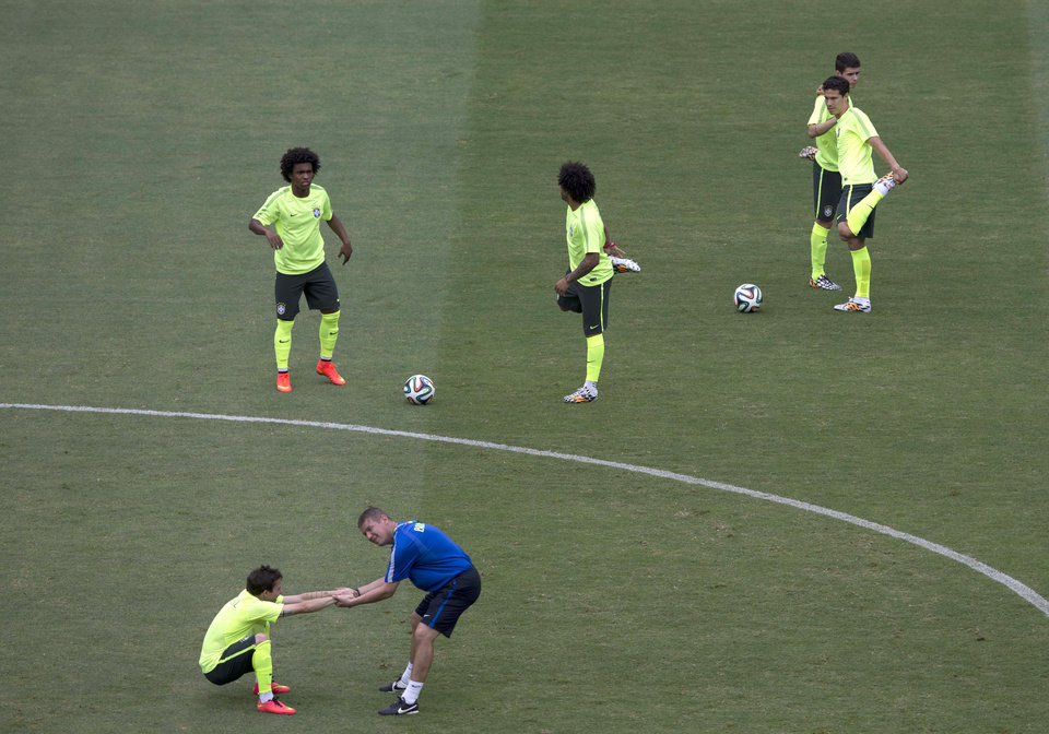 Photo - Brazil's national soccer team players train during an official training session the day before the group A World Cup soccer match between Brazil and Mexico, at the Arena Castelao in Fortaleza, Brazil, Monday, June 16, 2014.  (AP Photo/Eduardo Verdugo)