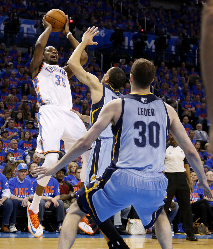 Photo - Oklahoma City's Kevin Durant (35) shoots over Memphis' Tayshaun Prince (21) during Game 7 in the first round of the NBA playoffs between the Oklahoma City Thunder and the Memphis Grizzlies at Chesapeake Energy Arena in Oklahoma City, Saturday, May 3, 2014. Photo by Nate Billings, The Oklahoman