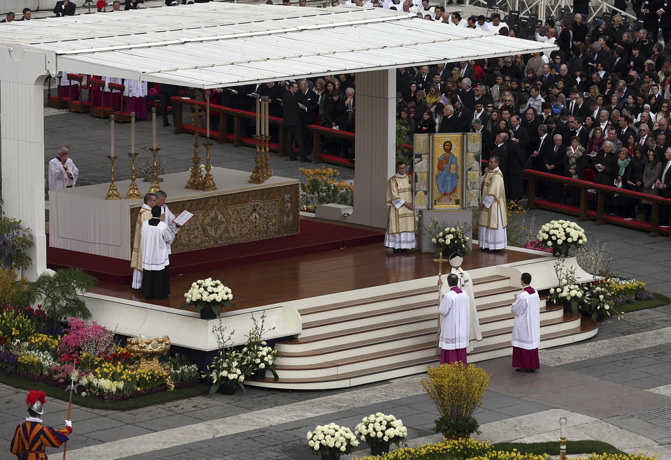 Pope Francis, holding the pastoral staff, prays in front of the icon of Jesus as he celebrates the Easter mass in St. Peter's Square at the Vatican, Sunday, March 31, 2013. Pope Francis is celebrating his first Easter Sunday Mass as pontiff in St. Peter's Square, which is packed by joyous pilgrims, tourists and Romans. (AP Photo/Gregorio Borgia)