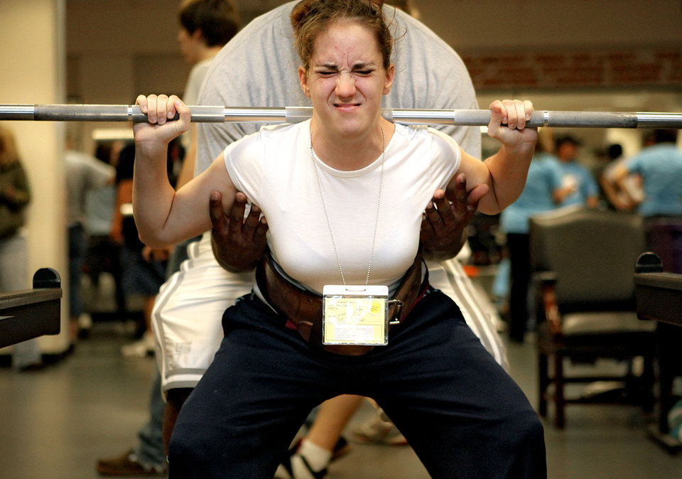 Caitlin Brown, of Wagoner, Okla. takes her first squat attempt during the powerlifting competition for the Special Olympics at Oklahoma State University (OSU) on Wednesday, May 13, 2009, in Stillwater, Okla.   Photo by Chris Landsberger, The Oklahoman