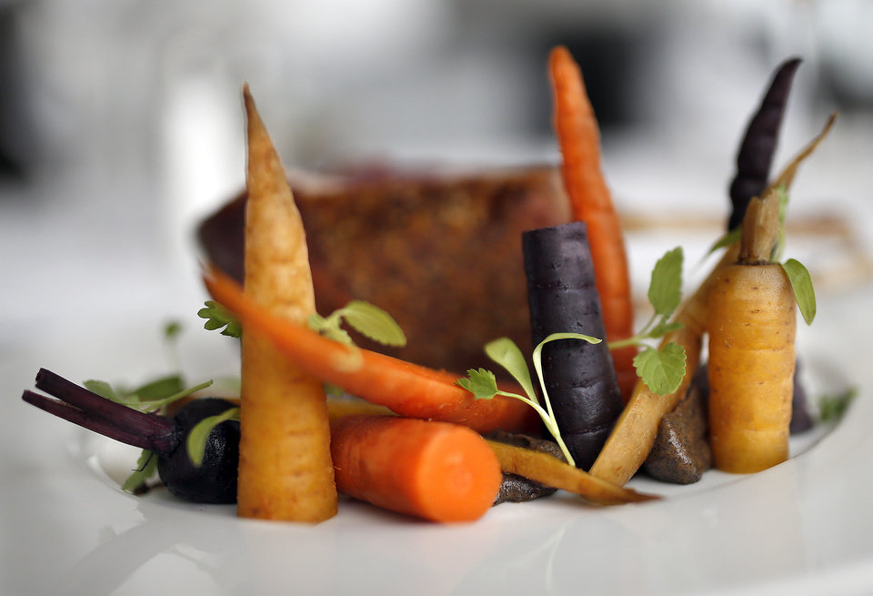 Photo - Carrots with a rack of lamb are pictured at the The George Prime Steakhouse in Oklahoma City, Thursday, June 20,  2014. Photo by Sarah Phipps, The Oklahoman