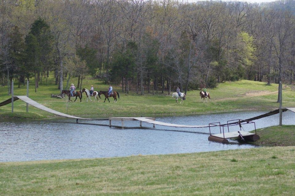 Photo - Riding horses is a favorite pastime at for visitors to the Buffalo Creek Ranch near Talihina. Photo provided
