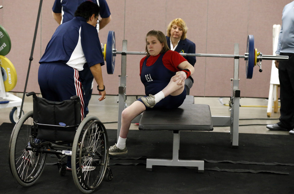 Photo - Chelsi Figley prepares to lift at the IPC Powerlifting competition during the Sports and Health Festival on Saturday, Feb. 16, 2013  in Oklahoma City, Okla. Photo by Steve Sisney, The Oklahoman