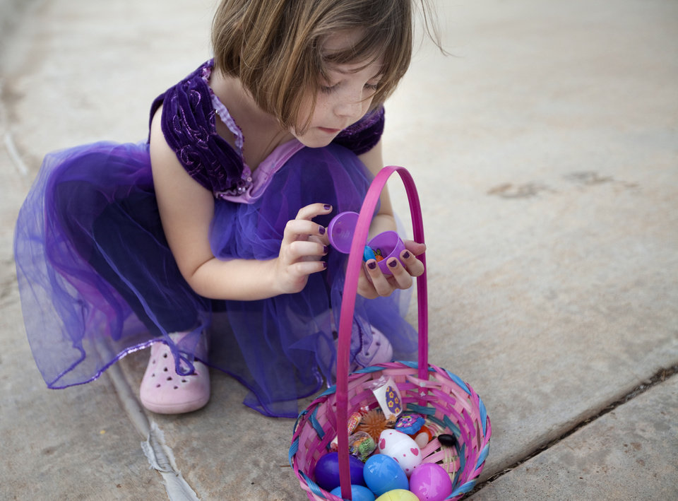 Lily Rose Botham  looks at her Easter eggs  an Easter egg hunt at ProCure in Oklahoma City, Saturday, April 7, 2012. Photo by Sarah Phipps, The Oklahoman