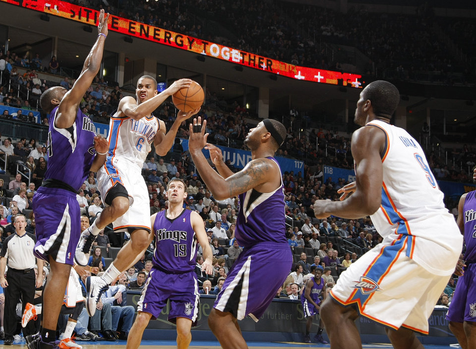 The Thunder's Eric Maynor (6) drives into the paint against the Kings' Carl Landry (24) during the NBA basketball game between the Oklahoma City Thunder and The Sacramento Kings on Tuesday, Feb. 15, 2011, Oklahoma City Okla.  Photo by Chris Landsberger, The Oklahoman
